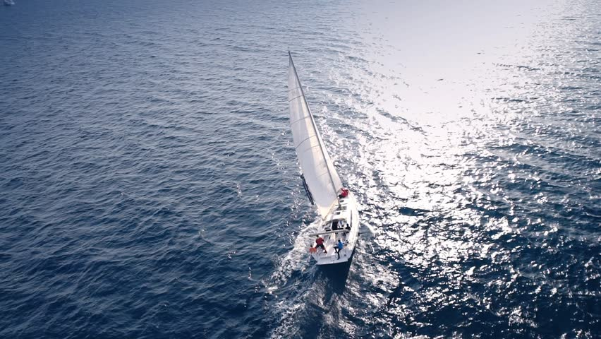 Yacht sailing on opened sea. Sailing boat. Yacht from drone. Yachting video. Yacht from above. Sailboat from drone. Sailing video. Yachting at windy day. Yacht. Sailboat. | Shutterstock HD Video #16596532