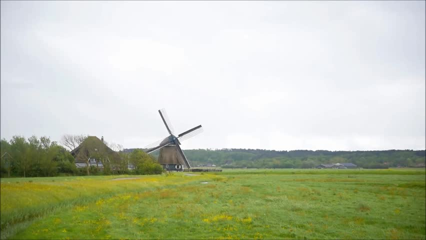 old windmill in Dutch fields during windy day - HD stock footage clip