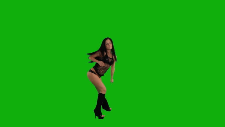 Beautiful young girl dancing against green screen  - HD stock video clip