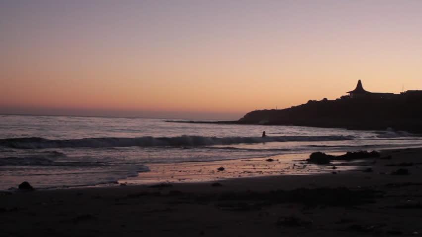 Waves crashing on the beach at sunset in Santa Cruz, California - HD stock video clip