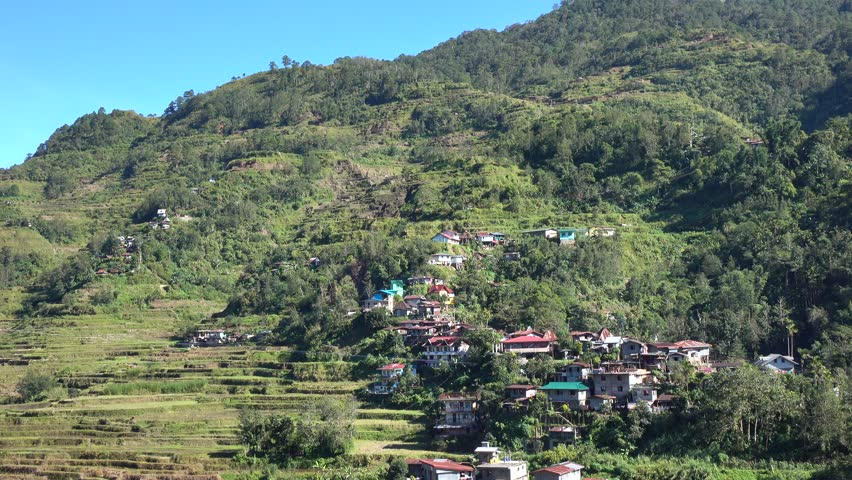Ifugao, Philippines - May 1, 2016: View of Banaue village with many houses on hill in Ifugao, Philippines.