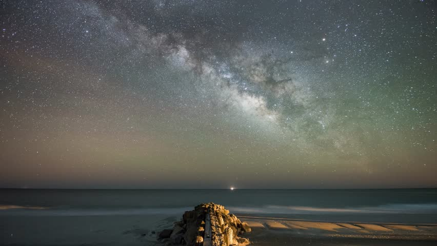 Edisto Beach Milky Way.  This is a 4k time lapse taken at Edisto Beach State Park, South Carolina of the wood pilings meeting the waters edge.