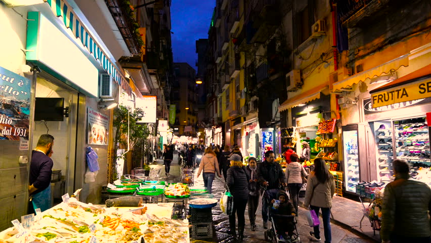 Naples - 25 FEB: People walking along a crowded alley lined with stores selling various items on 25 February 2016 in Naples, Italy