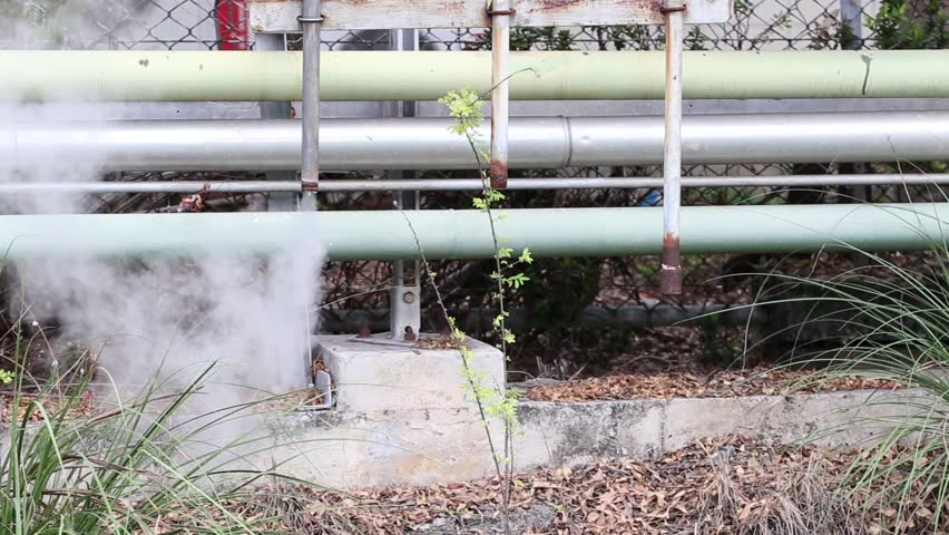 Steam Leak From Pipe : Steam leaking from a pipe in factory stock footage video