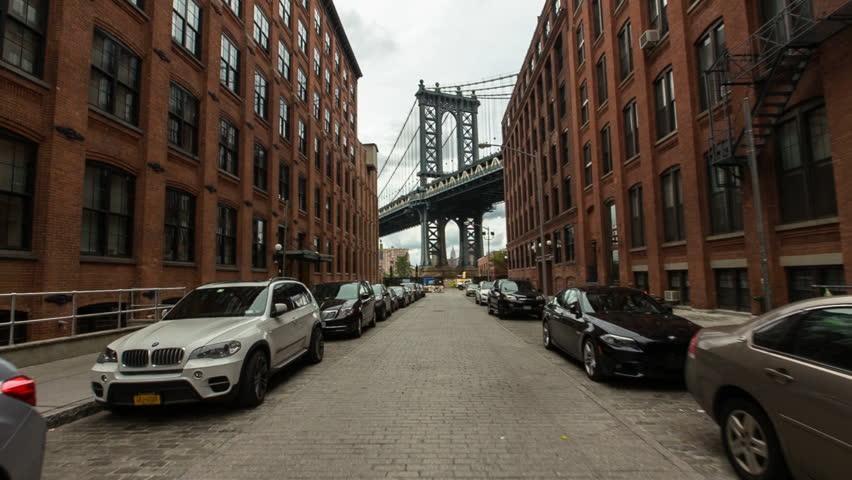 New York, USA - October 03, 2014: Manhattan Bridge viewed from narrow street, New York City, New York, USA | Shutterstock HD Video #16878313