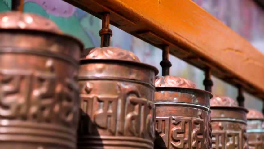 Spinning prayer wheels at the Boudhanath Stupa, Kathmandu, Nepal. Boudhanath Stupa (Bodnath Stupa) is the largest stupa in Nepal and the holiest Tibetan Buddhist temple outside Tibet.