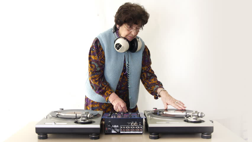 a very funky elderly lady dj, spinning records!! - HD stock footage clip