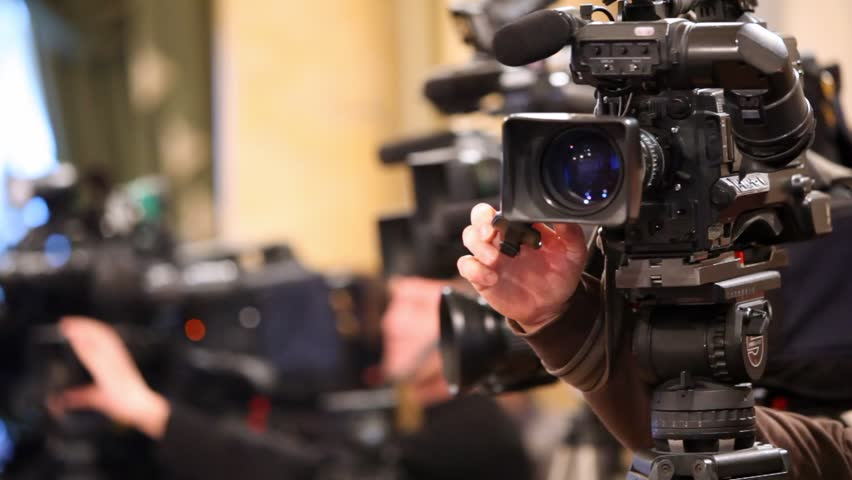 Videocamera and hands of operator, adjusting its close up - HD stock footage clip