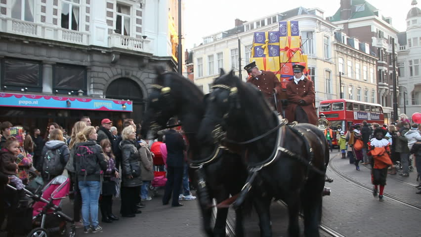 THE HAGUE, HOLLAND - NOVEMBER 12 - Horse-drawn cab with gifts rides in The Santa Claus (Sinterklaas) parade on November 12, 2011 in The Hague, Holland. Sinterklaas is a traditional festival in Holland - HD stock video clip