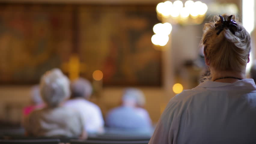 View from behind of people sitting in church in Copenhagen, Denmark - HD stock footage clip