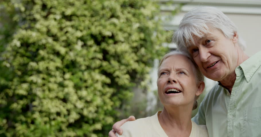 Lovely elder couple in the garden  - 4K stock video clip