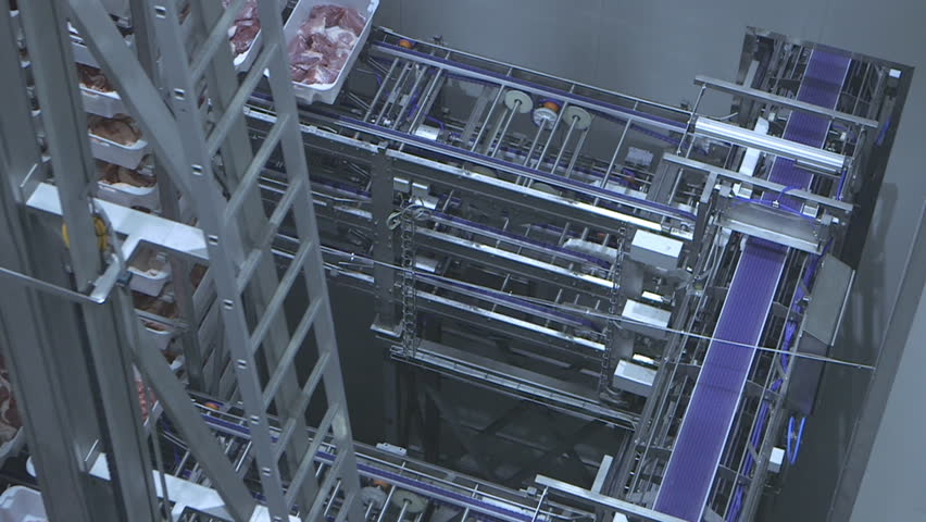 Panning over the automated dynamic storage with boxes stocked with meat.