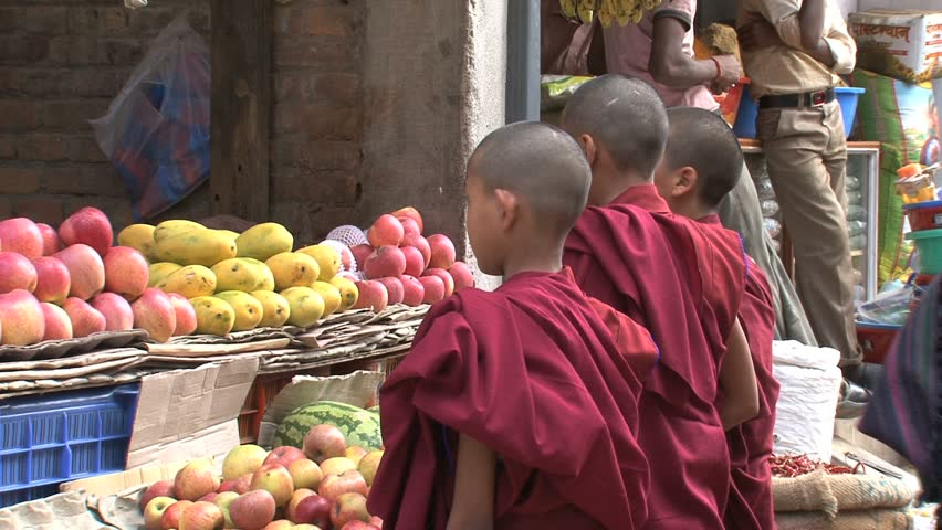 Young monks at fruit-stand near Boudha Stupa. - HD stock video clip