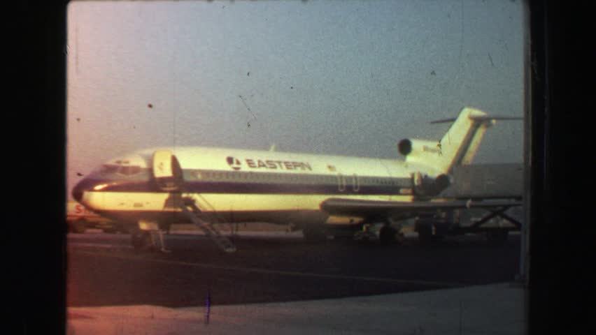 FREEPORT, BAHAMAS 1969: Eastern Airlines airplane parked on tarmac waiting to board and takeoff.