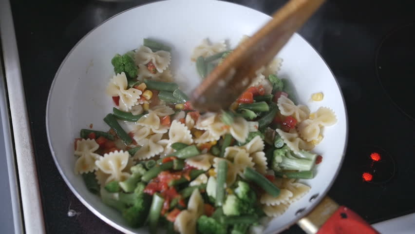 man preparing vegetables in a pan - HD stock video clip