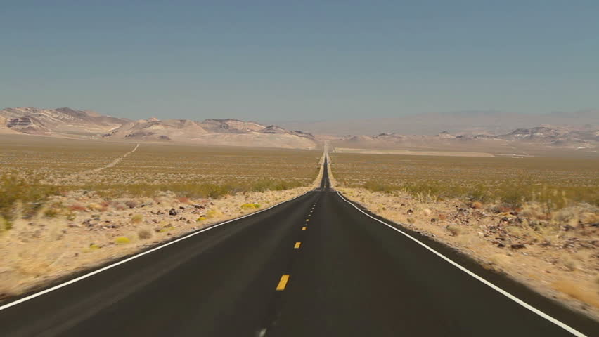 Driving shot on an empty road in Death Valley National Park #1715788