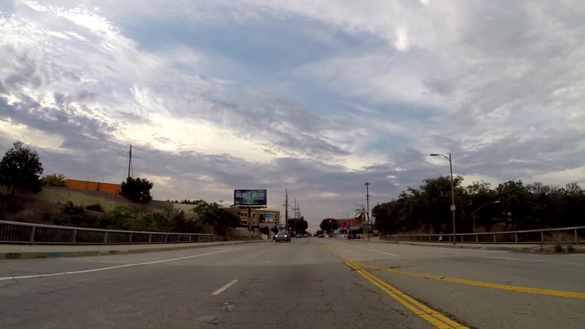 Los Angeles, California, USA - June 28, 2015:  Rear view car mount driving time lapse of the historic 6th street bridge in downtown Los Angeles. - HD stock video clip