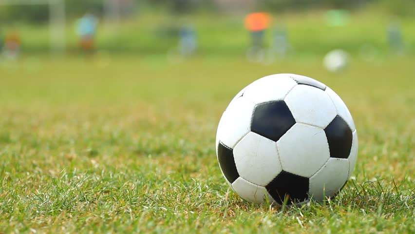 Soccer ball on the green grass with slider - HD stock video clip