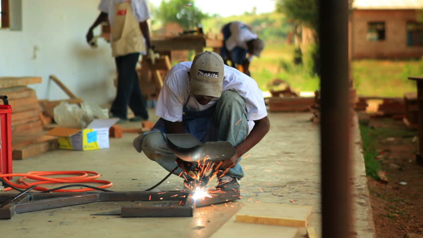 KENYA, AFRICA - CIRCA 2011: A metal worker does contruction in a village in Kenya two hours north of the African city Mombassa.