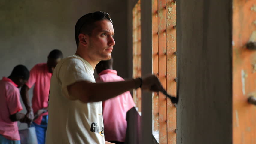MOMBASSA, KENYA, AFRICA - CIRCA 2011: Painting the interior of a school in a village in Kenya
