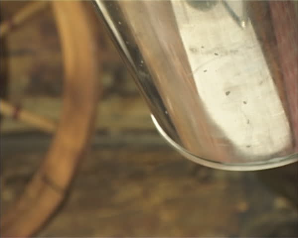 Milk flows from a metal bucket - SD stock video clip