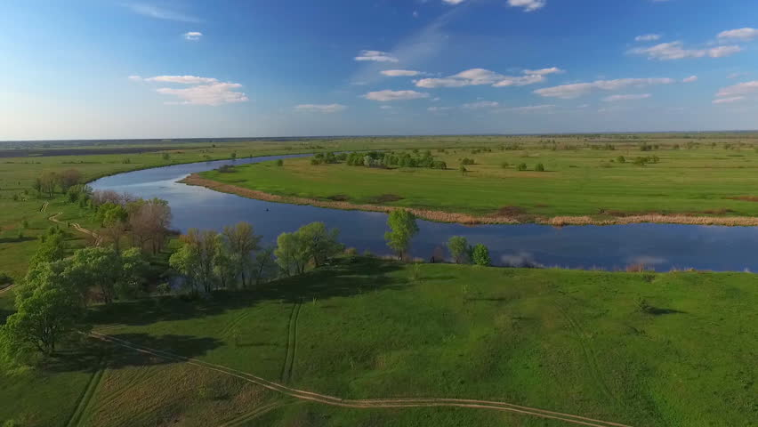 Quadrocopter Flying Over the Meadows and Canals, Over Fields and Dirt Roads. Bird's-Eye View Seen Rivers, Trees, Beaches, Lakes. the Territory of Ukraine Dniester River. | Shutterstock HD Video #17334856