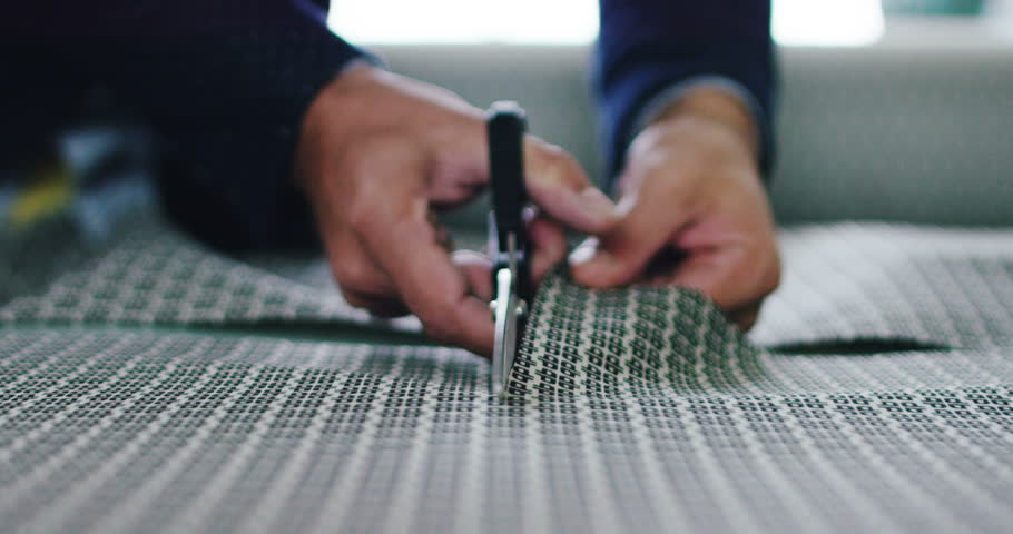A YOUNG hand of an Italian tailor sew or cut your fabric to make a suit tailored in slow motion