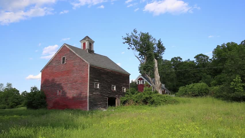 An old historic vintage red barn on a farm in Etna, New Hampshire.