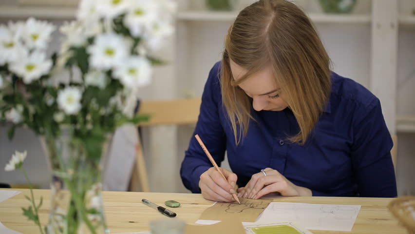 Young woman draws still life with pencil. Student learns to draft geometric shapes of object - HD stock video clip