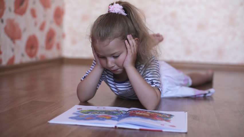 Children Education Boy Reading Book Lying Stock Photo