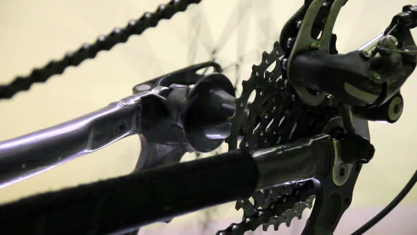 Video footage of a bicycle spinning wheel - HD stock video clip