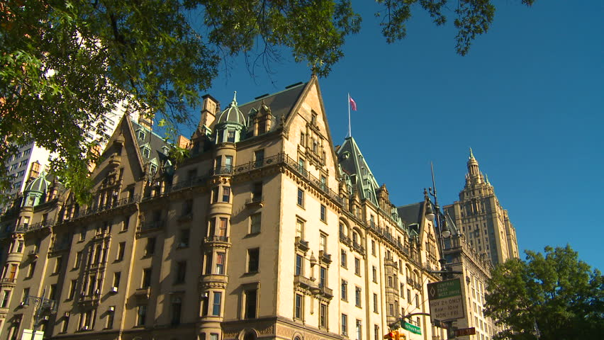 NEW YORK, NY - NOVEMBER 9, 2010: Pan down on the Dakota to street ambience on Central Park West