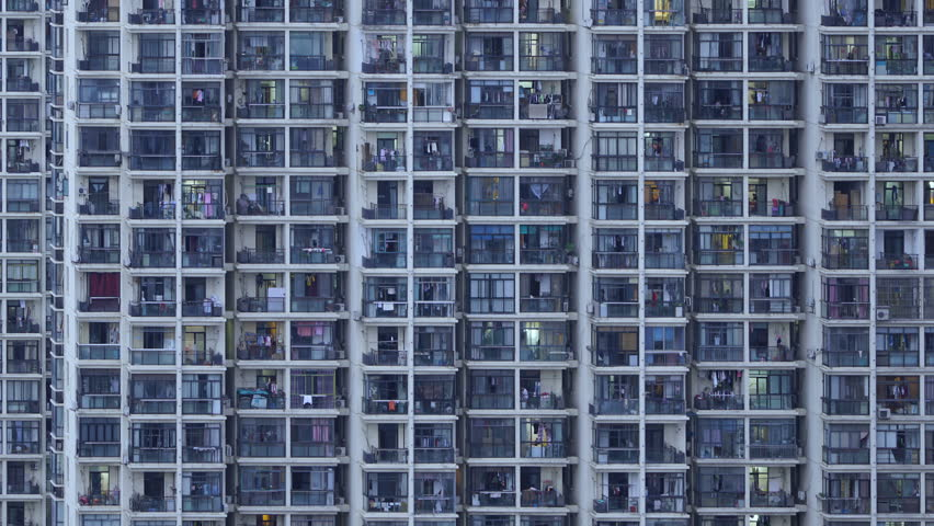 Timelapse of apartment windows at dusk to night. Nighttime time lapse of illuminated building windows at night with people living in flats with balcony in Shanghai, China. #17497837
