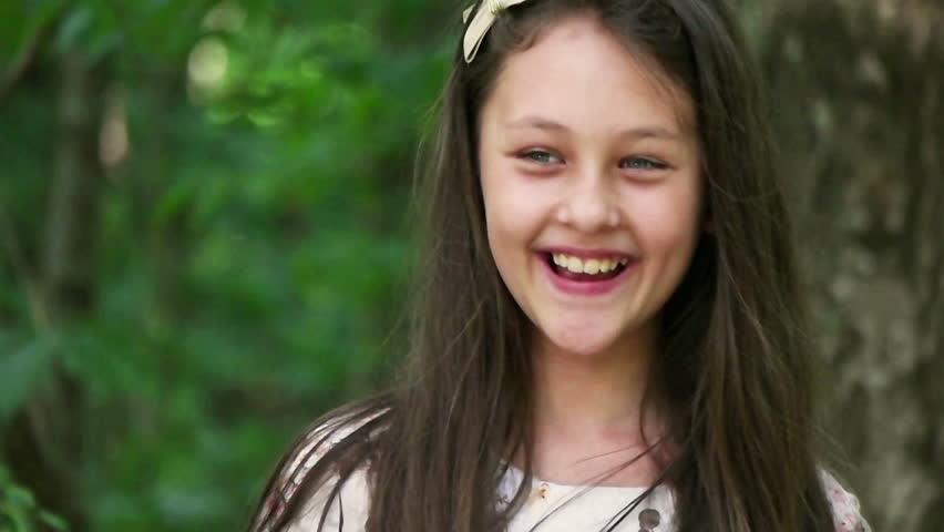 girl smiling outdoors | Shutterstock HD Video #17569072