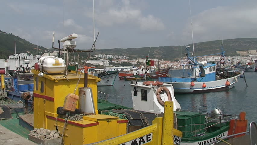 Colorful fishing boats in the port - HD stock video clip