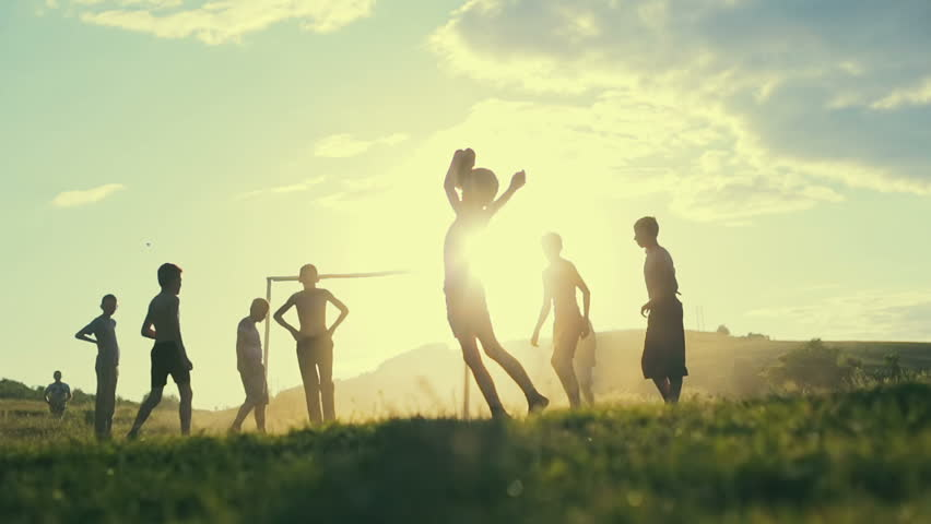 Unidentified children play football in a village on the background of sunset. Slow motion. | Shutterstock HD Video #17646247