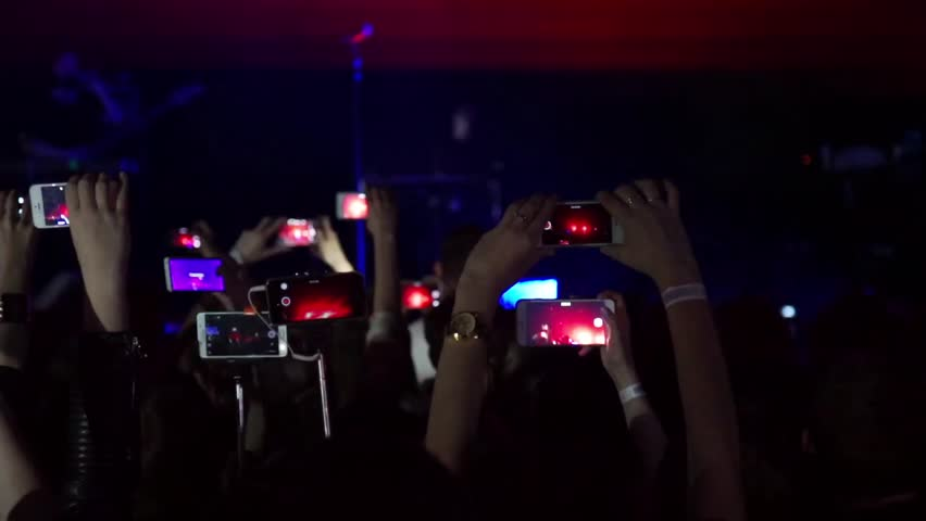 Making party at a rock concert and hold up cameras, phones and tablet with digital displays / Crowd making party at a rock concert. Hands hold cameras with digital displays among people | Shutterstock HD Video #17678422