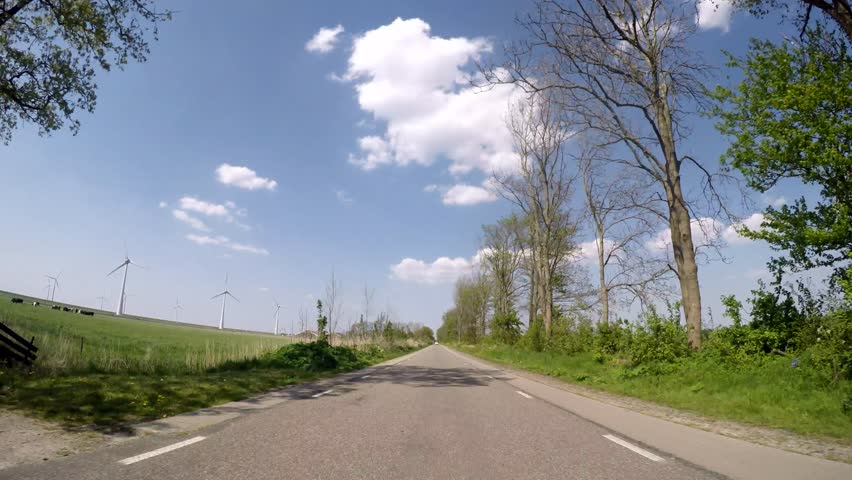 Video footage P.O.V. in 4K of driving in the netherlands in agricultural landscape - 4K stock footage clip