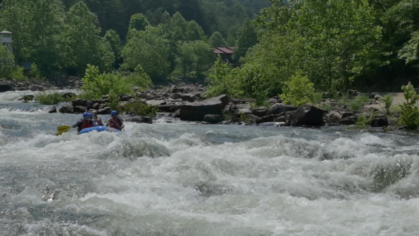 COPPER HILL, TENNESSEE / UNITED STATES - JUNE 12, 2016: extreme slow motion sports shot of white water rafters on Ocoee River at 200 FPS high speed camera with forest background and plenty of rapids. - HD stock footage clip