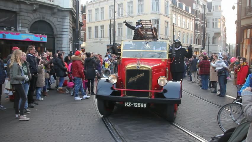 THE HAGUE, HOLLAND - NOVEMBER 12 - The Santa Claus (Sinterklaas) parade with a old fire engine arrives on November 12, 2011 in The Hague, Holland. Sinterklaas is a traditional festival in Holland - HD stock video clip