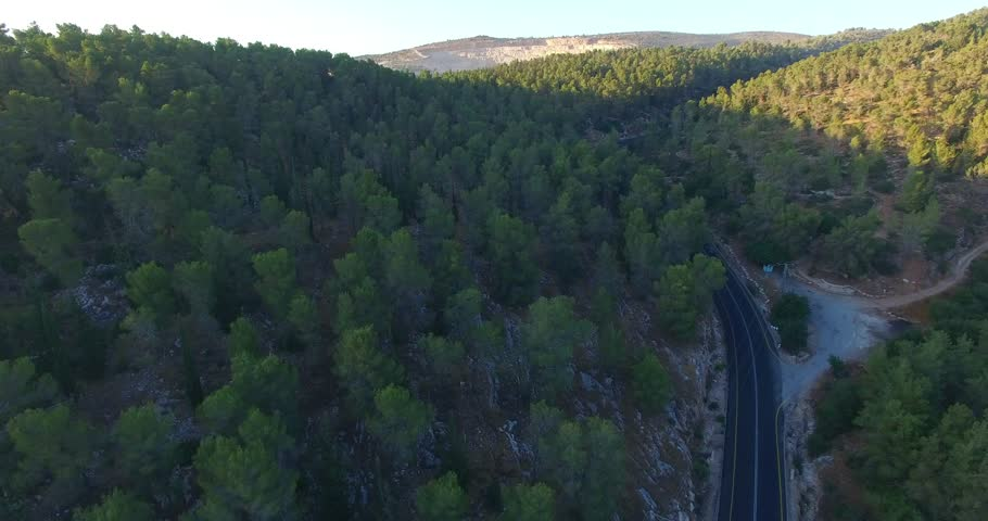 Aerial: Sunset on the mountain road