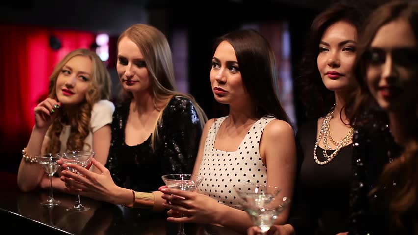 Beautiful girl talk in a bar and drink - HD stock footage clip