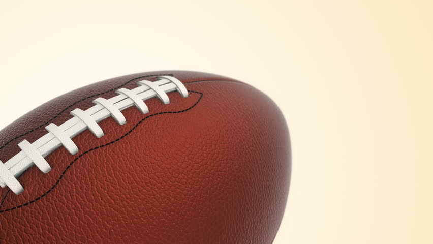 Animation of slow rotation ball for american football. View of close-up with realistic texture and light. Animation of seamless loop. | Shutterstock HD Video #17885566