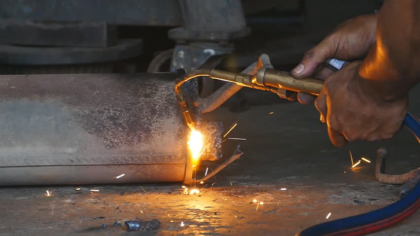 Industrial worker cutting steel by acetylene torch. - HD stock footage clip