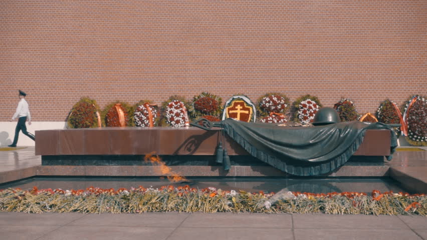 Eternal Flame at the Kremlin wall, and a large number of flowers and wreaths, the officer of the guard changing and the sentries. Slow motion, high speed camera, 250fps - HD stock video clip