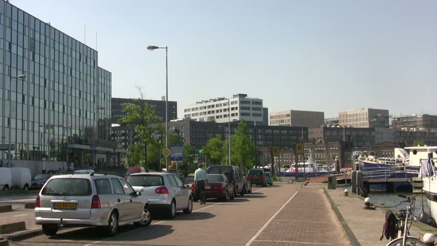 Modern street in the port of Amsterdam  - HD stock footage clip