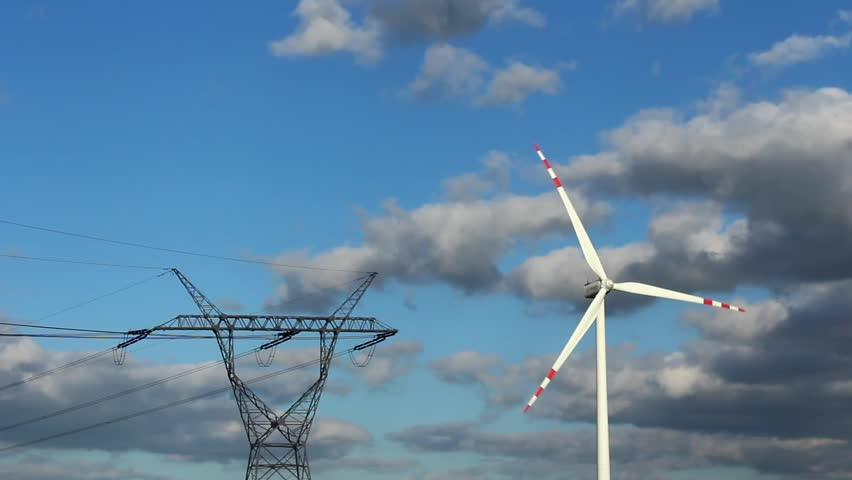 Wind power station turbines in sunny weather with clouds on wind - HD stock footage clip