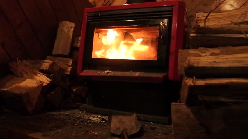 A Real Wood Fire Burning In A Clean Brick Fireplace Stock