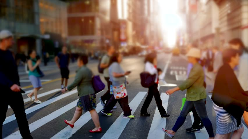 People walking in the city on crowded street. urban scenery of unrecognizable persons commuting to work in business district. new york metropolis scene background | Shutterstock HD Video #18131500