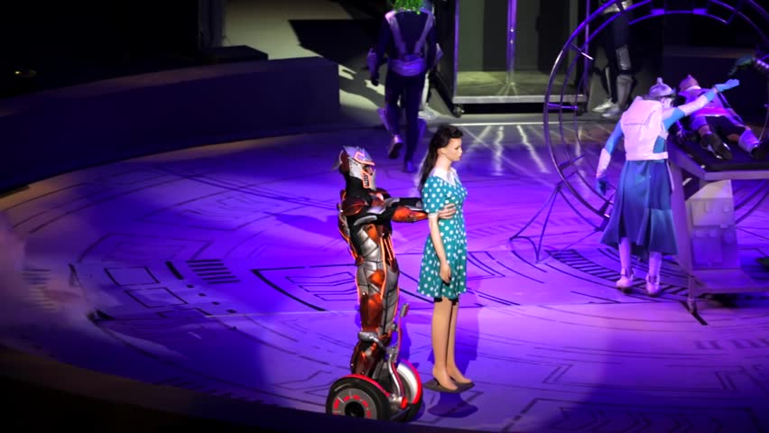 """ST. PETERSBURG, RUSSIA - JANUARY 2, 2016: Brothers Zapashny circus, """"UFO. Alien Planet Circus"""" show in Saint Petersburg. Alien drives on segway with human doll. Others do smth with man on stretcher"""